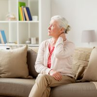 senior-woman-suffering-from-neck-pain-at-home-PUGE6Y7